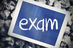 Exam against tablet pc with blue screen Royalty Free Stock Photo