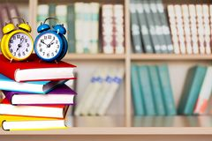 Exam. Book homework clock time stack education royalty free stock image