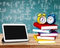Exam. Book Homework Clock Time Stack Education royalty free stock photos