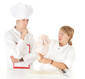 Exam for cook, cooks team and raw chicken Stock Image