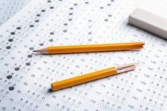 Exam form and broken pencil,. Closeup stock photos