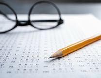 Exam form and pencil,. Closeup Stock Photos