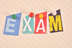 Exam. Pinned to lined paper Royalty Free Stock Photos