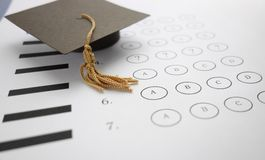 Exam question. Multiple choice exam with mini graduation cap Stock Image