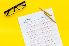 On the exam. Exam sheet, answer near glasses and pencil on yellow background top view copy space. On the exam. Exam sheet, answer near glasses and pencil on stock photography