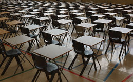 Exam tables. A sea of exam tables set out ready for test royalty free stock photography