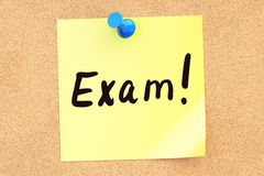 Exam. Text on a sticky note pinned to a corkboard. 3D rendering Royalty Free Stock Images