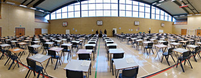 Exam time. Exam papers out ready to do in a panoramic shot in a sports hall royalty free stock photography