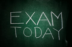 Exam today. Note written with chalk on the green chalkboard stock photos