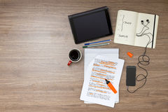 Exam week background. With various study and educted related items, such as a highlighted reader with standard (lorum ipsum) text, a cup of coffee, electronic Stock Image