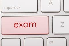 EXAM. Word written on computer keyboard Stock Photography