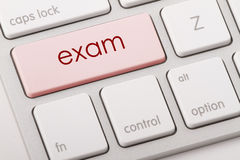 EXAM. Word written on computer keyboard Royalty Free Stock Image