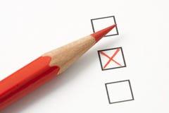 Exame com X vermelho e o lápis vermelho Fotografia de Stock Royalty Free