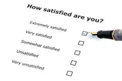 Exame da satisfação Fotografia de Stock Royalty Free