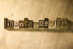 Examen de finances - signe de lettrage de typographie en métal Photo libre de droits