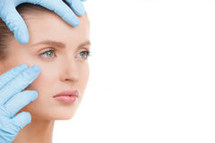 Examen de visage. Images stock