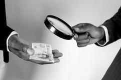 Examen del dinero Imagen de archivo libre de regalías