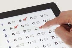 Examen en línea Imagen de archivo libre de regalías