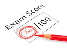 Examen final marcado con 100% Fotografía de archivo
