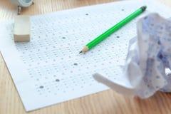 Examenform, blyertspenna och radergummi Royaltyfria Bilder