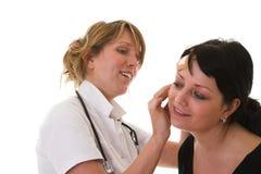 Examening el paciente Fotos de archivo