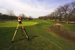 Examinando o campo de golfe Imagem de Stock