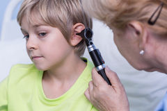 Examinating by otoscope Stock Photo