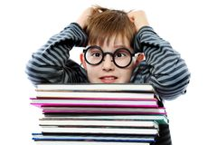 Examination. Educational theme: funny teenager with books. Isolated over white background royalty free stock images