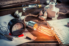 Examination of current and light bulbs in physics laboratory. Retro style Royalty Free Stock Photos