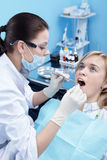 On examination in dentistry Royalty Free Stock Photography