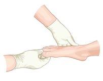Examination of the foot. Royalty Free Stock Photos