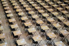 Examination hall set up with chairs and wooden desks. Photographed at Queen Mary, University of London. Mile End UK royalty free stock photography