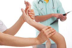 Examination of injured wrist Royalty Free Stock Photo