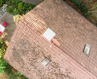 Examination of the roof of a house with a drone, aerial photograph, from the roof of a detached house Stock Photo