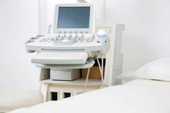 Examination Room With Ultrasonography Machine Stock Photo