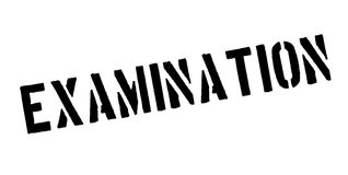 Examination rubber stamp Royalty Free Stock Photography