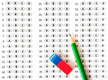 Examination test sheet with pencil. Education concept. Test answer sheet with pencil. Examination test. Education concept Stock Images