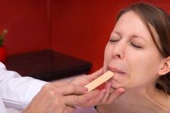 Examination with tongue depressor Stock Photos