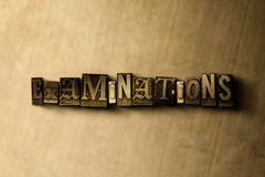 EXAMINATIONS - close-up of grungy vintage typeset word on metal backdrop Royalty Free Stock Photos