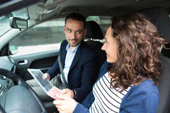 Examiner delivering driing licence to woman Royalty Free Stock Photo