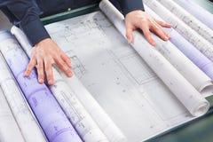 Examining architecture blueprint Royalty Free Stock Image