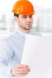 Examining a blueprint. Stock Photos