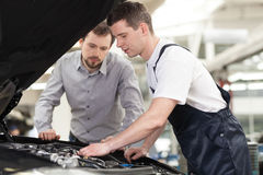 Examining a car. Royalty Free Stock Photo