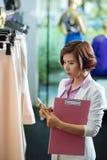 Examining clothes Royalty Free Stock Image