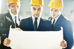 Examining construction plan Royalty Free Stock Image
