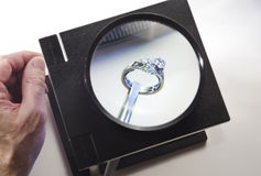 Examining diamond ring Royalty Free Stock Image