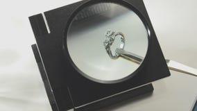 Examining diamond ring stock footage