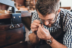 Examining every facet of the gem Stock Photo