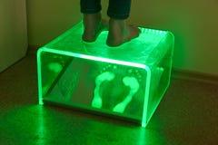 Examining feet using Plantoscopy Stock Photography
