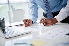Examining financial graph Stock Photography